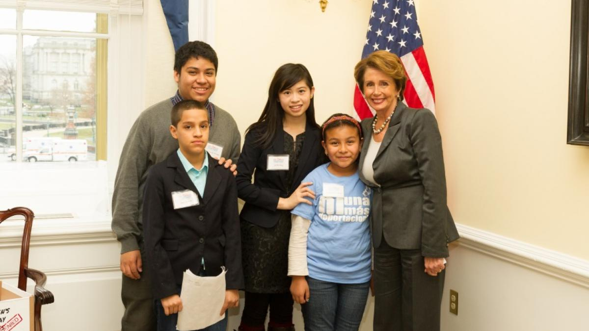 Congresswoman Pelosi and children from We Belong Together, including San Franciscan Nashali de la Rosa, discussing the urgency of comprehensive immigration reform.