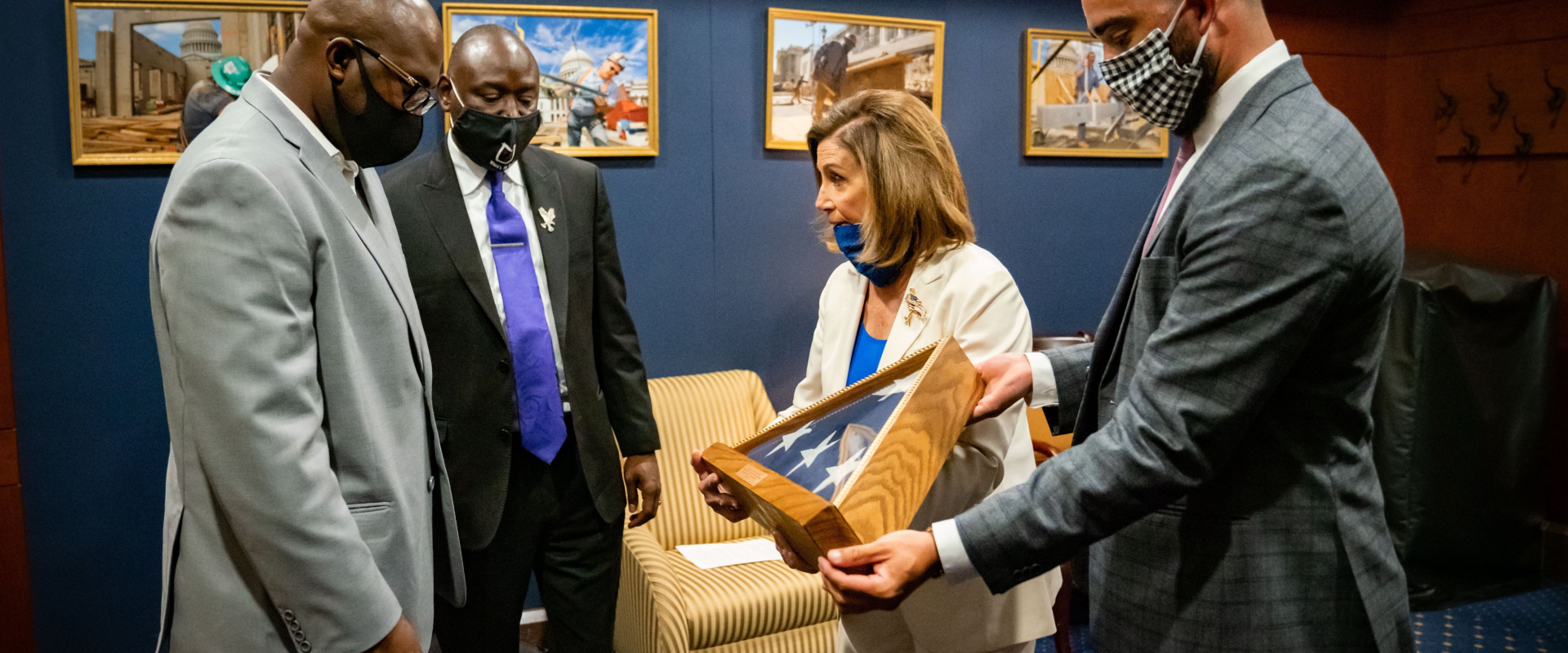 Congresswoman Nancy Pelosi talks with Philonise Floyd, George Floyd's brother, before his heart-wrenching testimony to the House Judiciary Committee hearing on Police Brutality & Racial Profiling. Congresswoman Pelosi presented Mr. Floyd an American flag