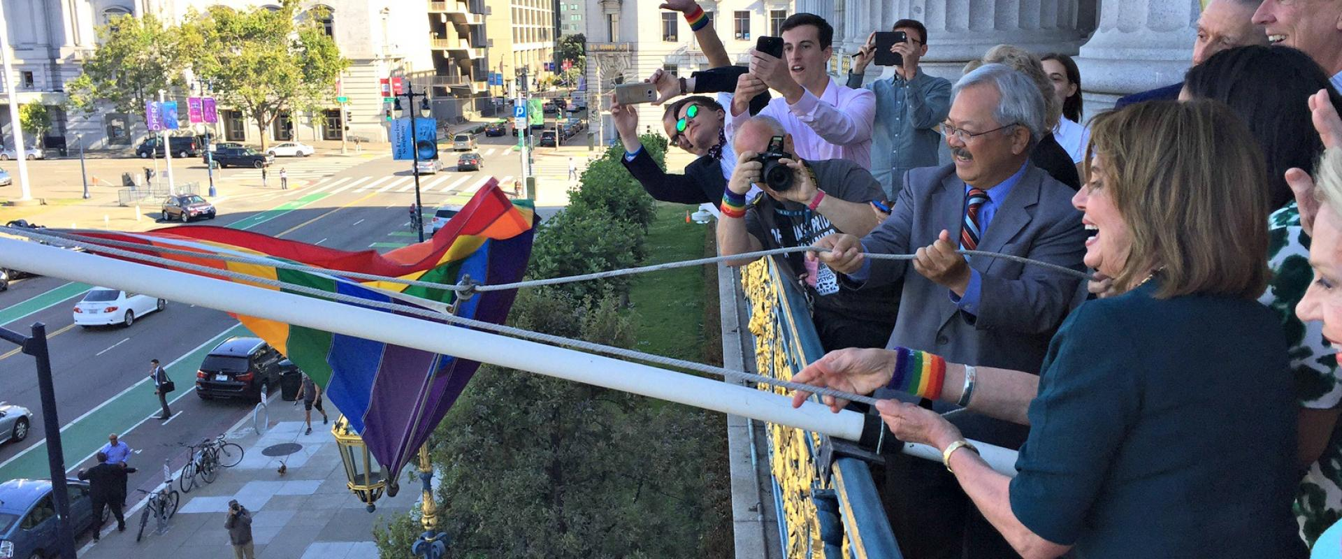 Congresswoman Pelosi and Mayor Ed Lee raise the Rainbow Flag at San Francisco City Hall in celebration of LGBTQ Pride. The ceremony honored the memory of Gilbert Baker, creator of the iconic rainbow flag which has become a symbol of the LGBTQ community re