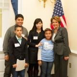 Congresswoman Pelosi and children from We Belong Together, including San Franciscan Nashali de la Rosa, discussing the urgency of comprehensive immigration reform.