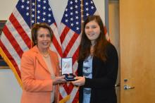 Congresswoman Pelosi presents Claire Dashe, 2015 Bronze Congressional Medal Awardee, with her award in San Francisco