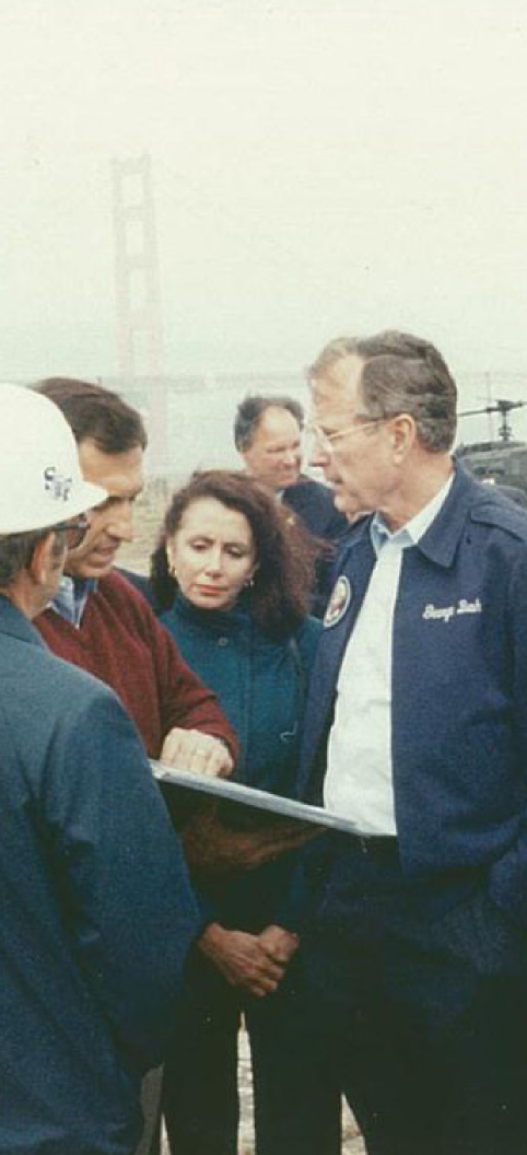 Congresswoman Nancy Pelosi, Mayor Art Agnos, and President George H.W. Bush view damage and discuss recovery efforts at Crissy Field days after the Loma Prieta earthquake in October 1989.