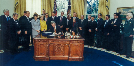 Nancy Pelosi with President Clinton as he signs the Presidio Trust Act in November 1996