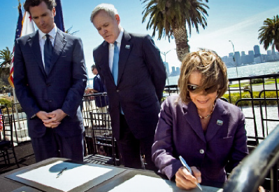 Nancy Pelosi, Navy Secretary Mabus and Mayor Newsom signing the transfer of Treasure Island to San Francisco in August 2010