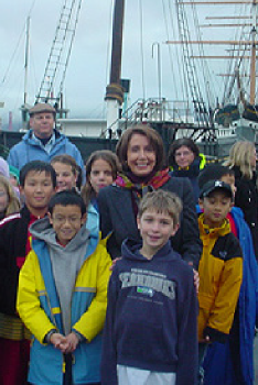 Pelosi joins schoolchildren at the C.A. Thayer before it departed for restoration in December 2003.